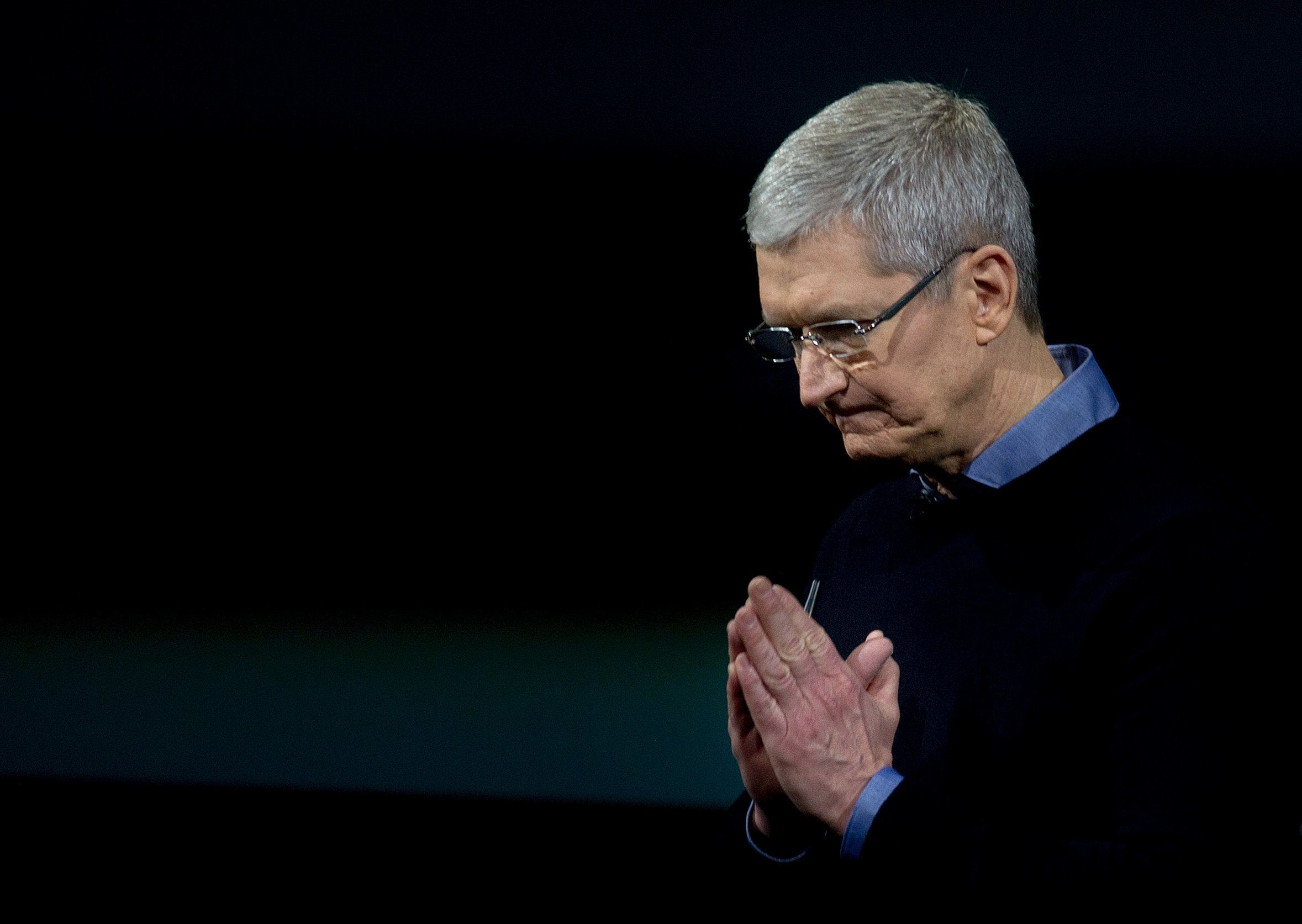 Apple CEO Tim Cook gestures during a media event at Apple headquarters in Cupertino, California on March 21, 2016. Apple on Monday unveiled a new iPhone with a four-inch screen, aiming to reach consumers looking for a handset that is more affordable and compact than its flagship models. / AFP / Josh Edelson        (Photo credit should read JOSH EDELSON/AFP/Getty Images)