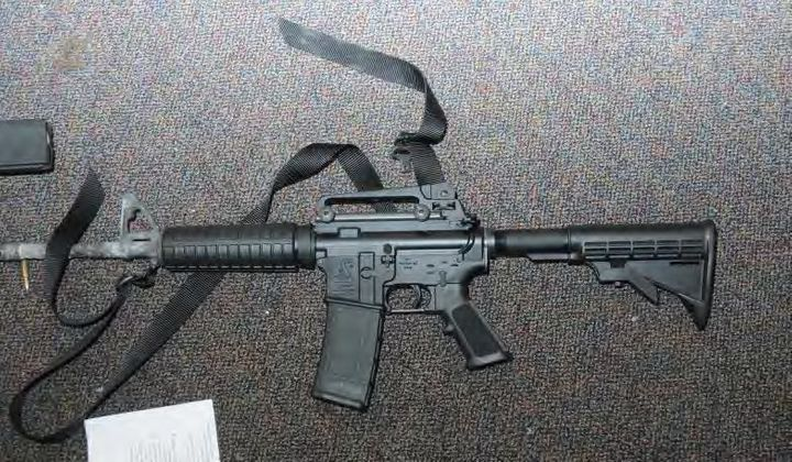 This crime scene evidence photo provided by the Connecticut State Police, shows a Bushmaster rifle in Room 10 at Sandy Hook E