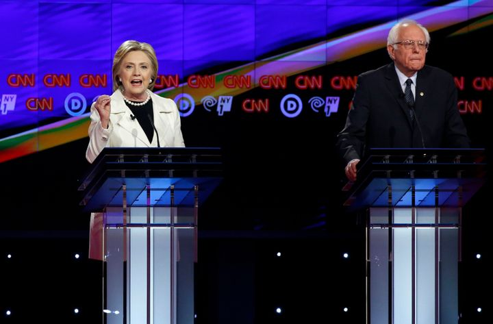 Democratic presidential hopefulHillary Clinton speaks as Sen.Bernie Sanders (I-Vt.) listens during a Democratic d