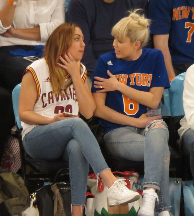 Miley's diamond ring was clearly on show when she enjoyed a basketball match with her sister just weeks