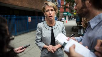 NEW YORK, NY - SEPTEMBER 09:  Zephyr Teachout, a democratic primary challenger to New York Governor Andrew Cuomo, speaks to reporters outside a voting station at Public School 153 on September 9, 2014 in New York City. Teachout has gained unexpected traction in the primary season, campaigning on ending corruption in the state capital of Albany.  (Photo by Andrew Burton/Getty Images)
