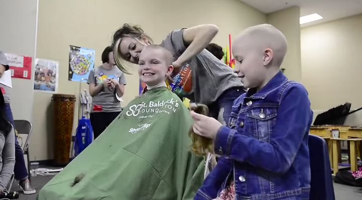 Student gets her head shaved atMeridian Elementary School.