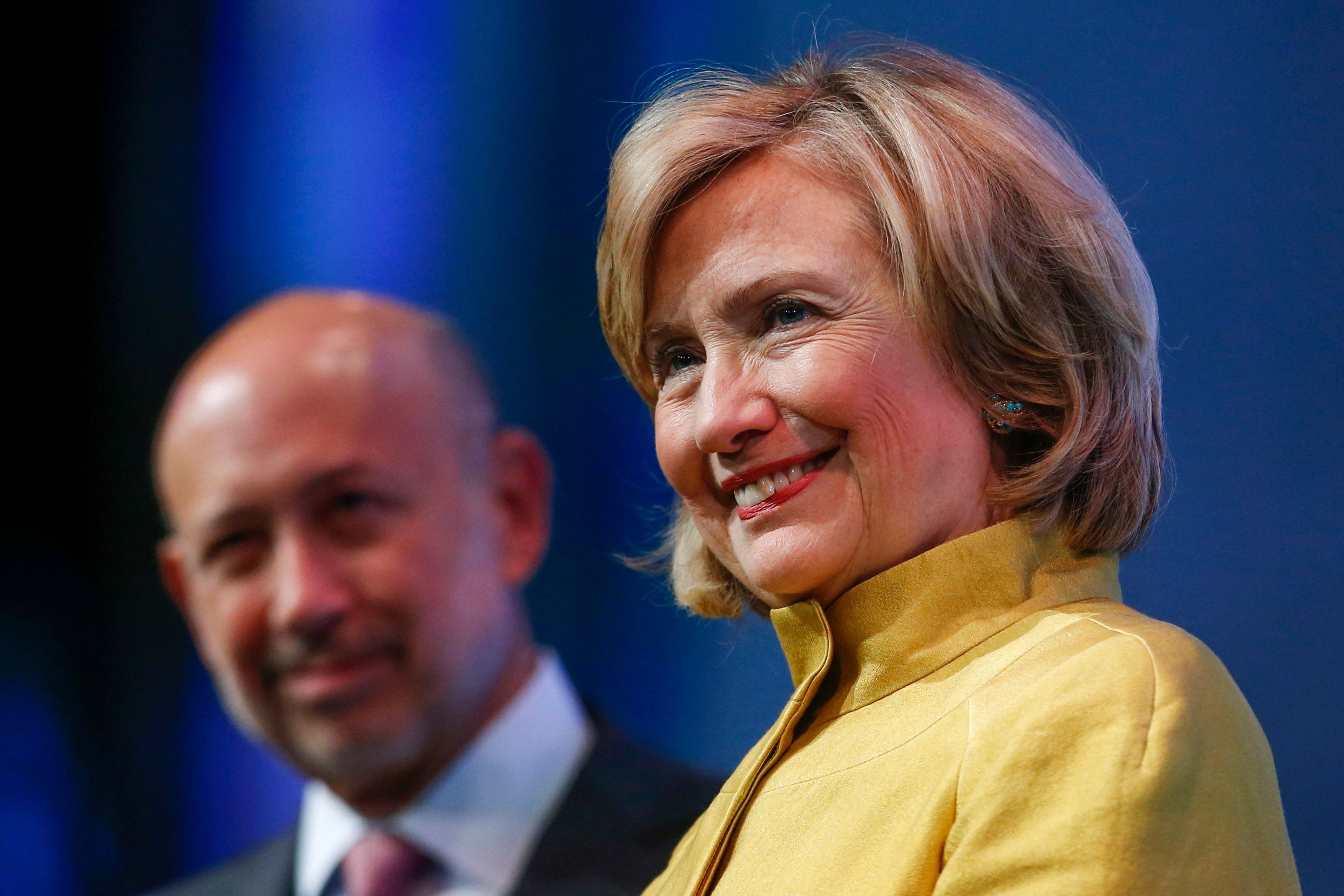 "Former U.S. Secretary of State Hillary Clinton and Goldman Sachs Group Inc. Chairman and Chief Executive Officer Lloyd Blankfein listen to speakers during the plenary session titled ""Equality for Girls and Women: 2034 Instead of 2134?"" at the Clinton Global Initiative 2014 (CGI) in New York, September 24, 2014. The CGI was created by former U.S. President Bill Clinton in 2005 to gather global leaders to discuss solutions to the world's problems. REUTERS/Shannon Stapleton (UNITED STATES - Tags: POLITICS BUSINESS SOCIETY)"
