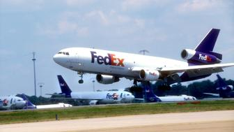 A FedEx plane lands during the day on Thursday, Aug. 17, 2006 at the FedEx hub in Memphis, Tenn. Express package delivery company FedEx Corp. on Wednesday said its fiscal second-quarter profit rose 9 percent on strong results from its ground delivery business and raised its full year guidance. (AP Photo/Greg Campbell)