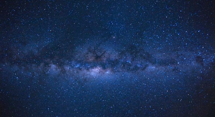 Our Milky Way galaxy, as seen from the French island of Reunion in the Indian Ocean. There are about four dozen galaxies that we know of which circle it.