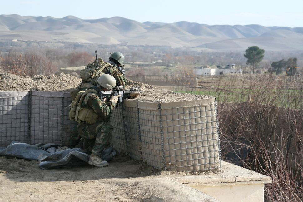 Marines with the 2nd Marine Special Operations Battalion scan the horizon during a patrol through Bala Marghab, Afghanistan.
