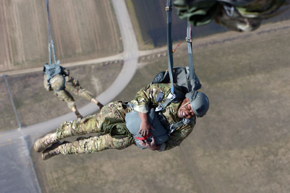 A soldier assigned to 10th Special Forces Group (Airborne) free-falls after jumping out of a C-130 Hercules aircraft over Ger