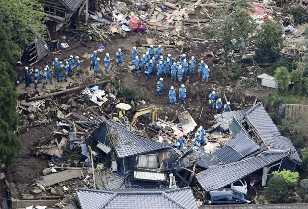 Rescue workers conduct a search and rescue operation in Minamiaso town. Dozens are thought to be trapped...