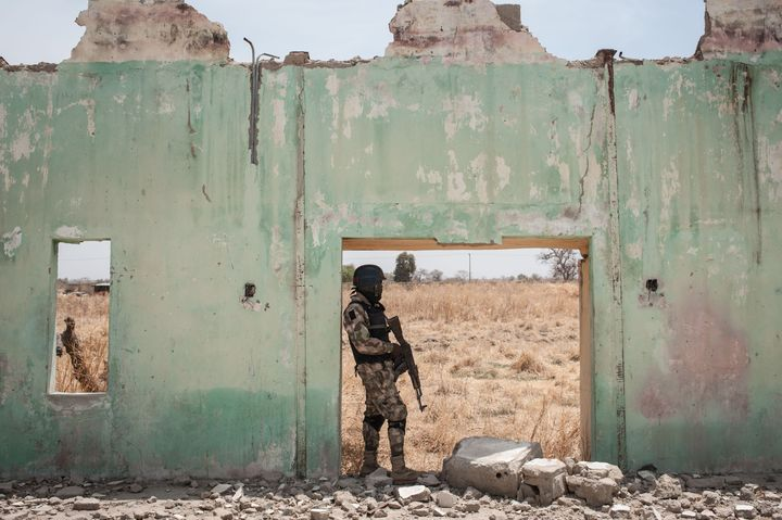 A Nigerian soldier stands amidst the ruins of the Government Girls Secondary School Chibok in Nigeria in March. Boko Haram ki