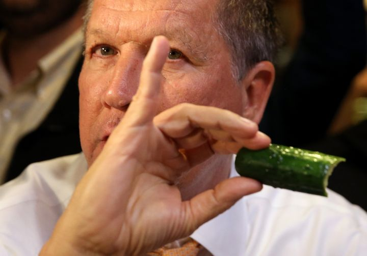 """The color of the pickle in Kasich's handindicates it isnot a """"full sour"""" pickle."""
