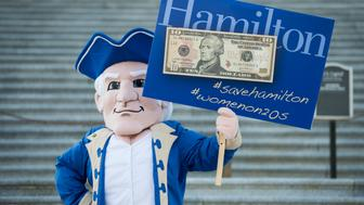 UNITED STATES - SEPTEMBER 16:  Hamilton College mascot 'Alex' aka Alexander Hamilton poses for photos on the House steps holding a sign to save Alexander Hamilton on the ten dollar bill on Wednesday, Sept. 16, 2015. (Photo By Bill Clark/CQ Roll Call)