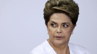 Brazil's President Dilma Rousseff looks on during signing of federal land transfer agreement for the government of the state of Amapa at Planalto Palace in Brasilia, Brazil, April 15, 2016. REUTERS/Ueslei Marcelino      TPX IMAGES OF THE DAY