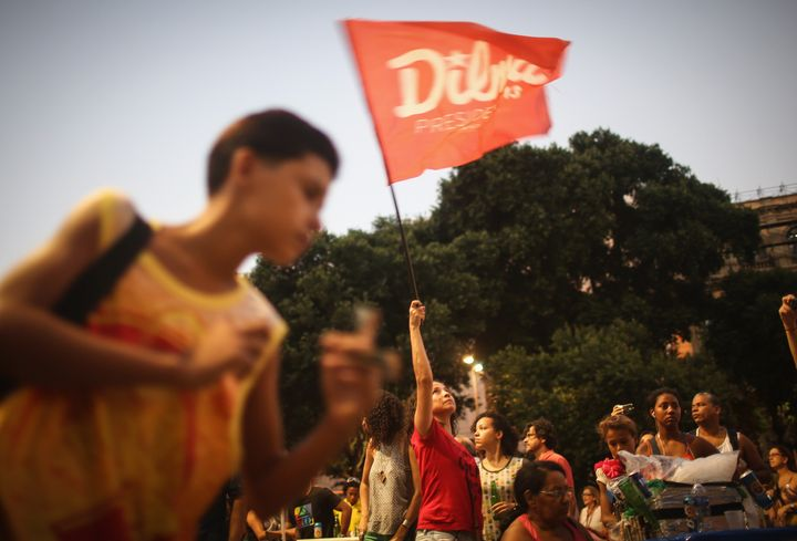 A supporter of President Dilma Rousseff waves a Dilma flag at a 'Carnival for Democracy' on April 16, 2016 in Rio de Janeiro,
