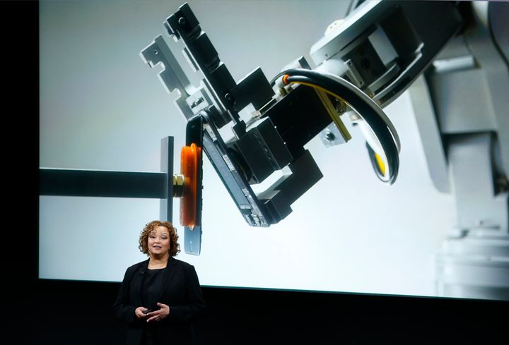 Lisa Jackson, Apple vice president for environment, policy and social initiatives, introduces a robot named Liam that deconst