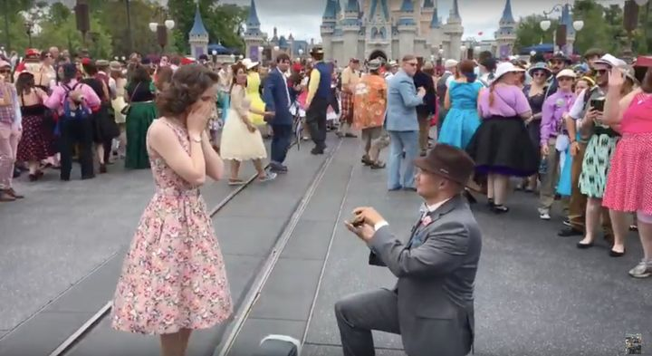 There wereseveral marriage proposals, with one woman surprised during a group photo shoot.