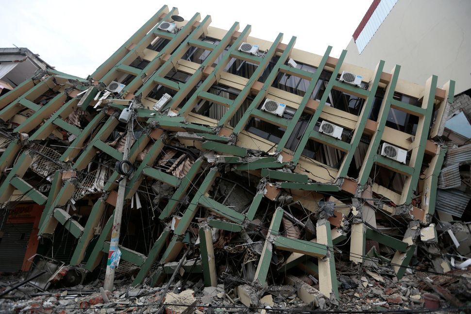 A fallen building after a 7.8-magnitude quake in Portoviejo, Ecuador, on April 17, 2016.