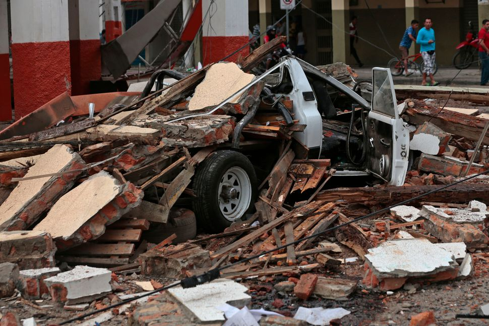 Avehicle squashed by rubble after the7.8-magnitude quake in Portoviejo, Ecuador, on April 17, 2016.