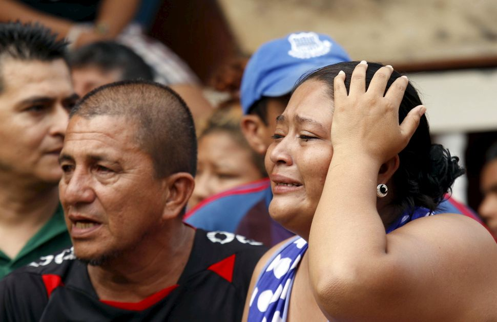 People react after an earthquake struck off Ecuador's Pacific coast, at the Tarqui neighborhood in Manta on April 17, 2016.