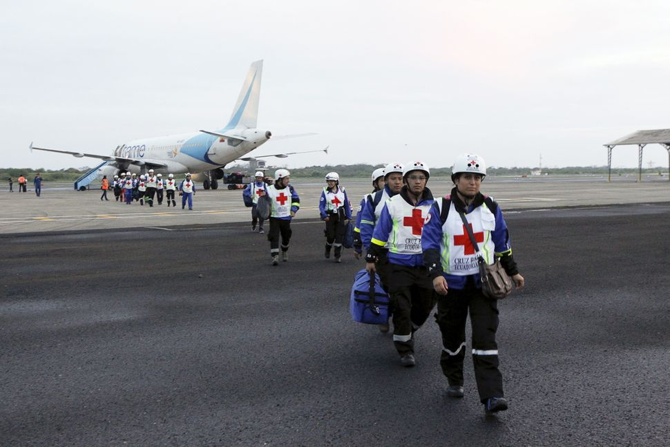 Red Cross members arrive at Eloy Alfaro Airport after an earthquake struck off Ecuador's Pacific coast, in Manta on April 17,