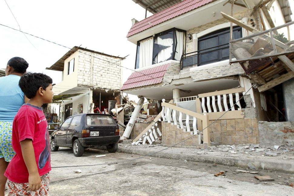Acollapsing buildingis pictured after an earthquake struck off Ecuador's Pacific coast, in theTarqui neighb