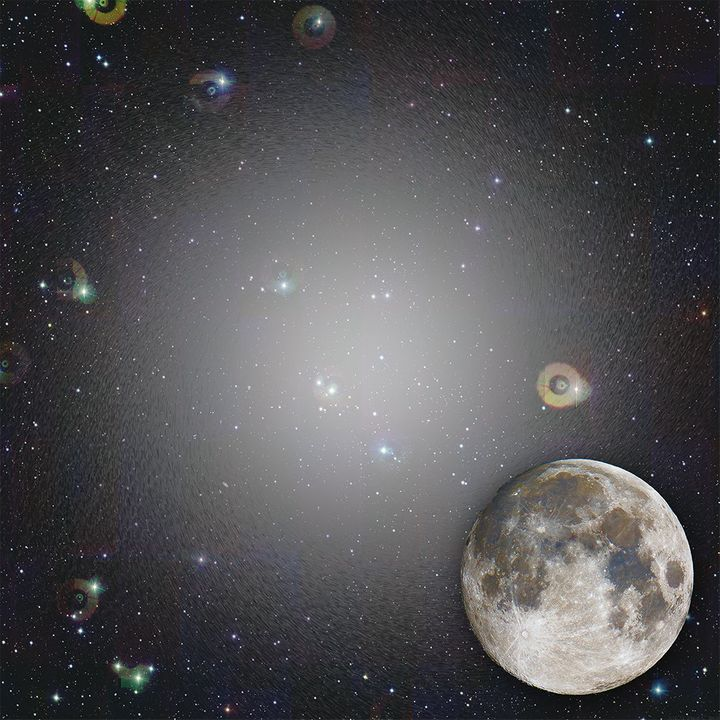 An artist's illustration of what Crater 2 would look like if it was a few thousand times more luminous than actually it is. The Moon is shown to scale for comparison.