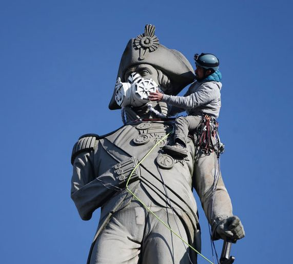 Nelson's Column And Sherlock Holmes Given Air Pollution Masks In Greenpeace