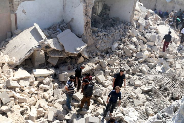 Residents look for survivors amidst the rubble after an airstrike on the rebel-held Old Aleppo, Syria last weekend.