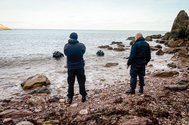Police divers at Anstey's Cove, where Polge's car was