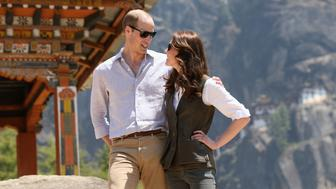 THIMPHU, BHUTAN - APRIL 15:  Prince William, Duke of Cambridge and Catherine, Duchess of Cambridge pose next to a prayer wheel on the trek up to Tiger's Nest during a visit to Bhutan on the 15th April 2016 in Thimphu, Bhutan. The Royal couple are visiting Bhutan as part of a week long visit to India and Bhutan that has taken in cities such as Mumbai, Delhi, Kaziranga, Bhutan and Agra.  (Photo by Chris Jackson/Getty Images)