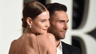 BEVERLY HILLS, CA - FEBRUARY 22:  Model Behati Prinsloo and musician Adam Levine arrive at the 2015 Vanity Fair Oscar Party Hosted By Graydon Carter at Wallis Annenberg Center for the Performing Arts on February 22, 2015 in Beverly Hills, California.  (Photo by Axelle/Bauer-Griffin/FilmMagic)