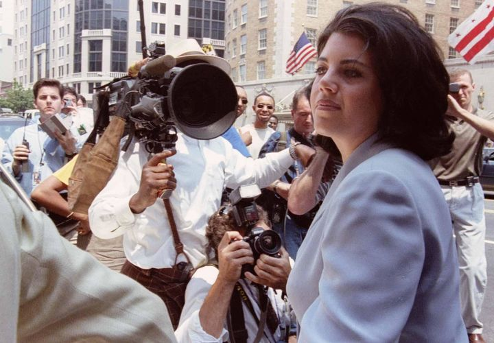 Lewinsky in 1998 is overwhelmed by photographers and reporters as she walks into her lawyer's office.