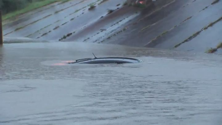 The man's vehicle is seen almost completely submerged just seconds after he climbed out to safety.