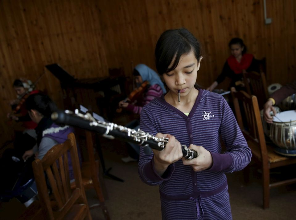 A member of the Zohra orchestra prepares for a rehearsal at Afghanistan's National Institute of Music, in Kabul, Afghanistan