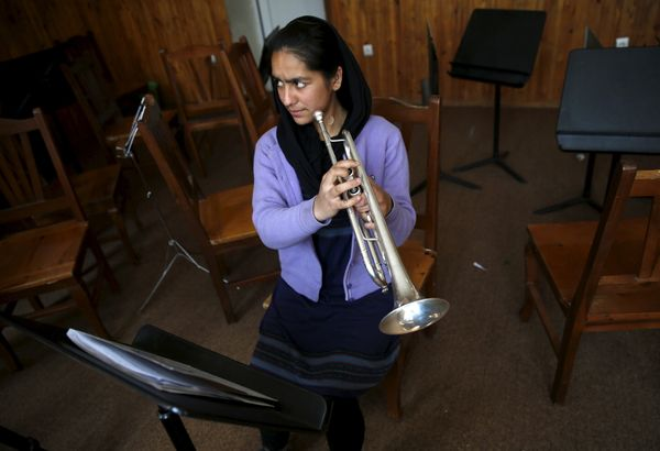 """""""When I have my musical instruments with me, people talk a lot behind my back,"""" said Mina Salarzai, a trumpeter in the orches"""