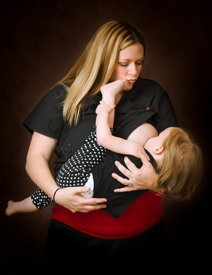 A labor and delivery nurse breastfeeds her daughter.
