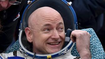 U.S. astronaut Scott Kelly reacts shortly after landing near the town of Dzhezkazgan (Zhezkazgan), Kazakhstan, March 2, 2016. REUTERS/Kirill Kudryavtsev/Pool