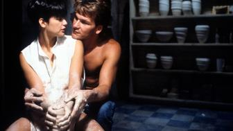 Demi Moore is embraced by Patrick Swayze in a scene from the film 'Ghost', 1990. (Photo by Paramount/Getty Images)
