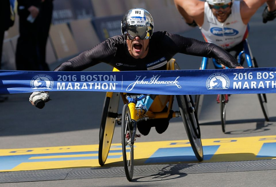 Marcel Hug of Switzerland crosses the finish line to win the men's wheelchair division of the 120th Boston Marathon on A