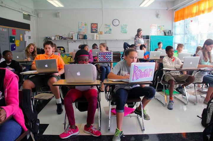 Students at Lovett Elementary, the Clinton, Miss. school district's sixth-grade-only school, work on laptops during class. Th