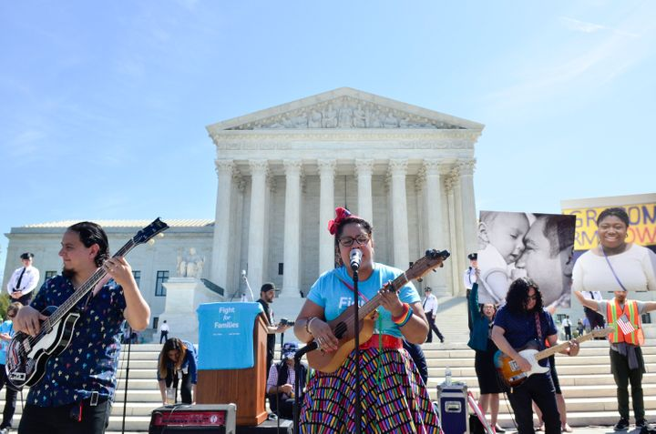 "Alex Bendana, La Marisoul and Miguel Ramirez of ""La Santa Cecilia"" perform during the Fight For Families Rally in front"