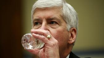 """Michigan Governor Rick Snyder drinks some water as he testifies before a House Oversight and government Reform hearing on """"Examining Federal Administration of the Safe Drinking Water Act in Flint, Michigan, Part III"""" on Capitol Hill in Washington March 17, 2016.  REUTERS/Kevin Lamarque"""