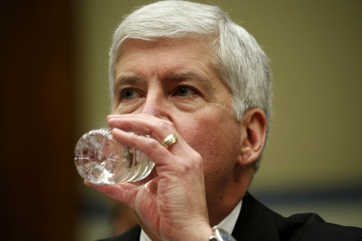 Michigan Gov. Rick Snyder (R) drinks some water as he testifies about Flint, Michigan's lead crisis in Washington on March 17