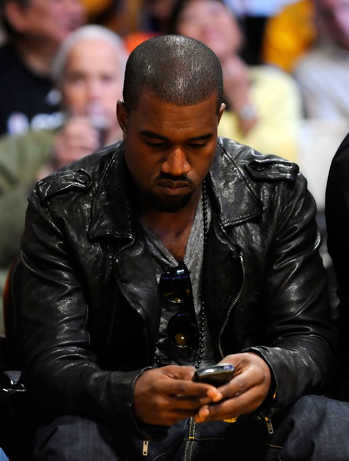 Here's Kanye on his phone in 2009.
