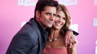 John Stamos, left, and Lori Loughlin arrive at the 2016 TV Land Icon Awards at Barker Hangar on Sunday, April 10, 2016, in Santa Monica, Calif.(Photo by Rich Fury/Invision/AP)