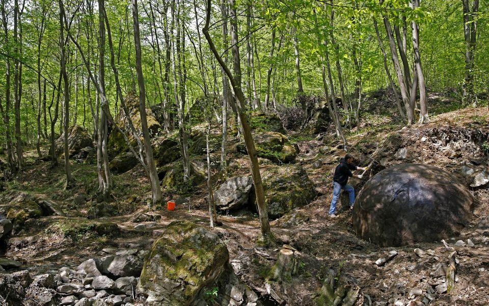 Suad Keserovic cleans a stone ball in Podubravlje village near Zavidovici, Bosnia and Herzegovina April 11, 2016. Hundreds of