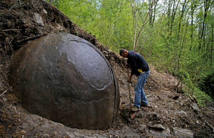Suad Keserovic cleans a stone ball in Podubravlje village near Zavidovici, Bosnia and Herzegovina, April 11, 2016. Keserovic