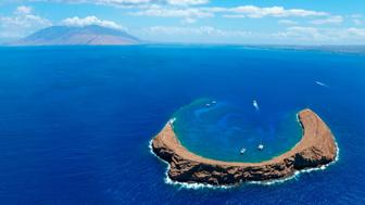 Molokini Crater with West Maui in background.
