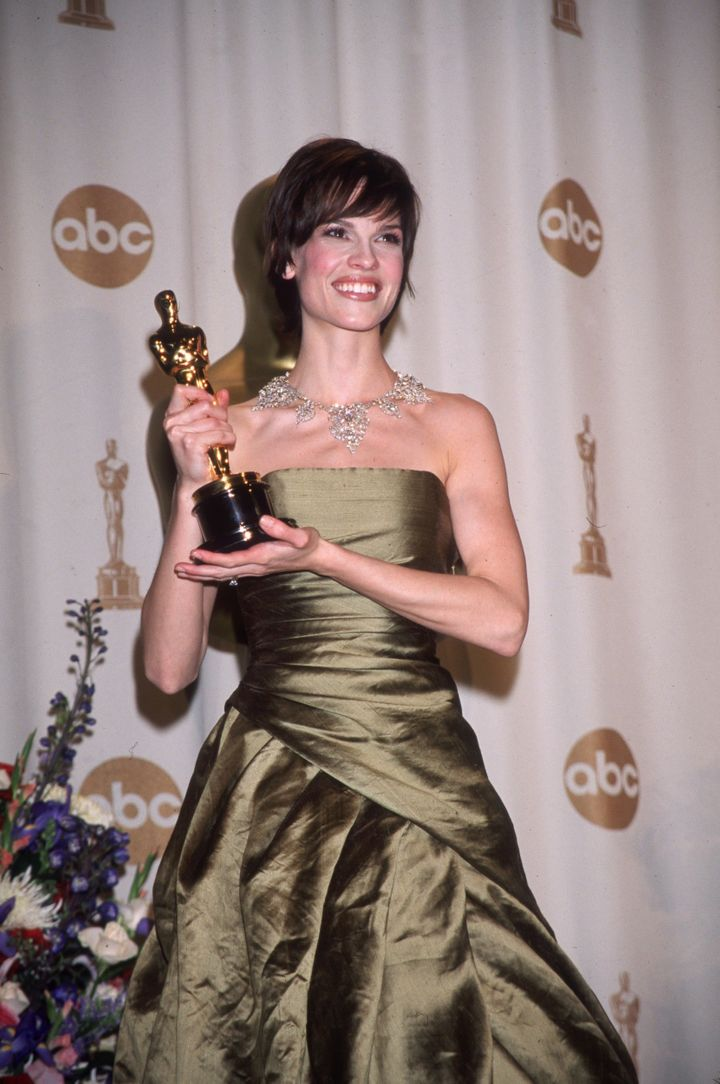 Hilary posing with her Oscar after winning for her role in Boys Don't Cry.