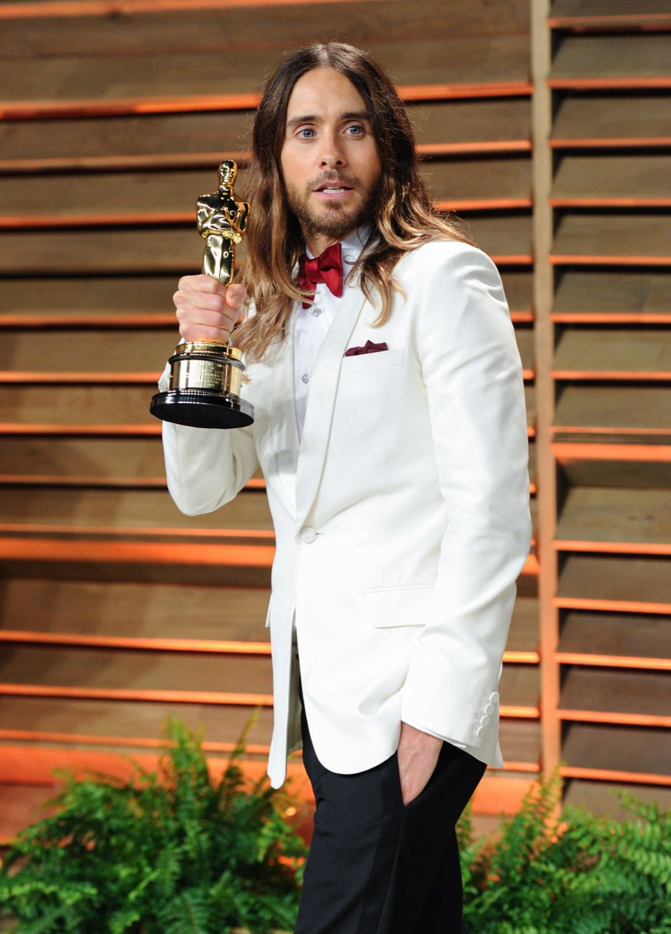 Jared Leto holding his Oscar for Best Supporting