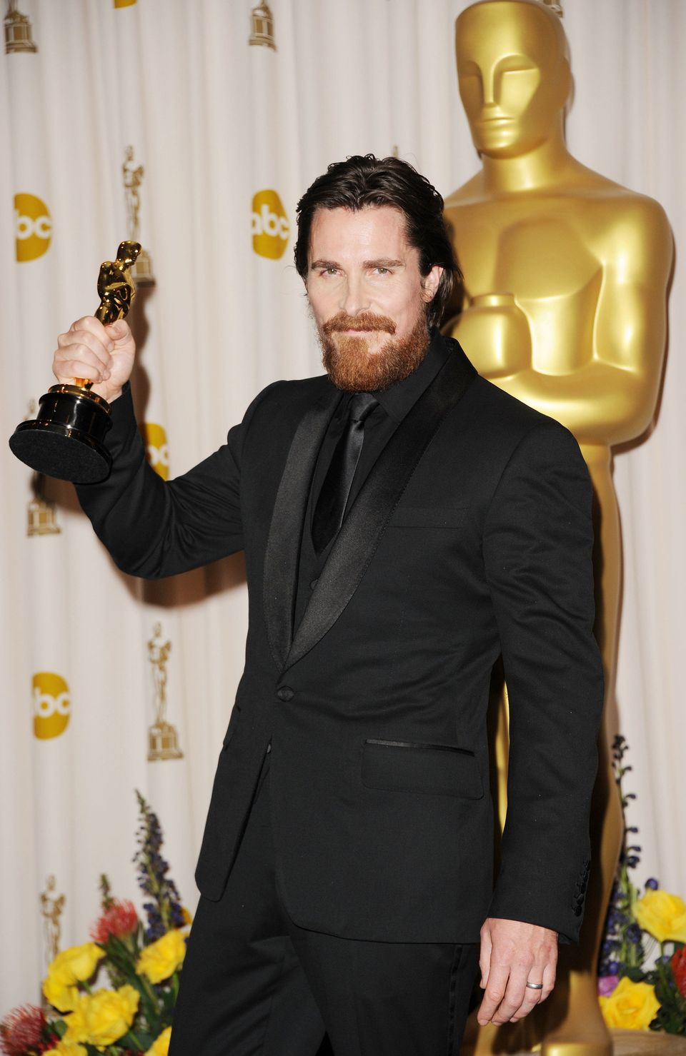 Christian Bale holds his Oscar statue after winning for his role in The